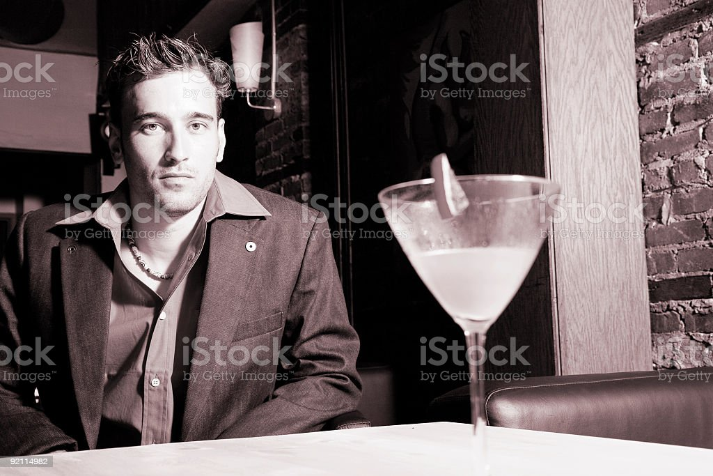 sepia  man in a bar stock photo