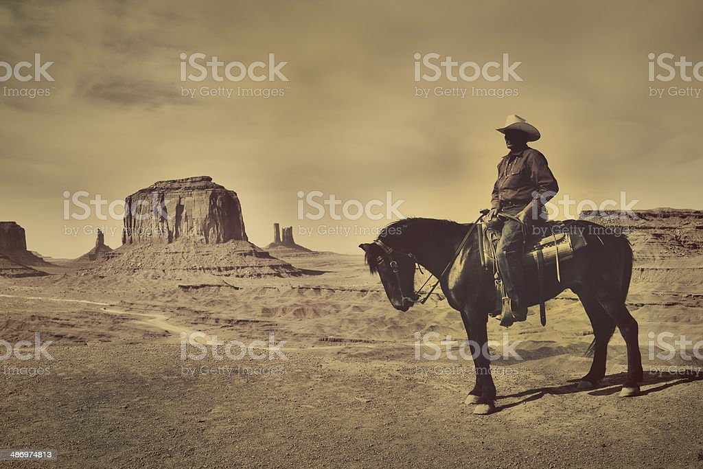 Sepia Navajo Cowboy on Horse Back in American Southwest stock photo