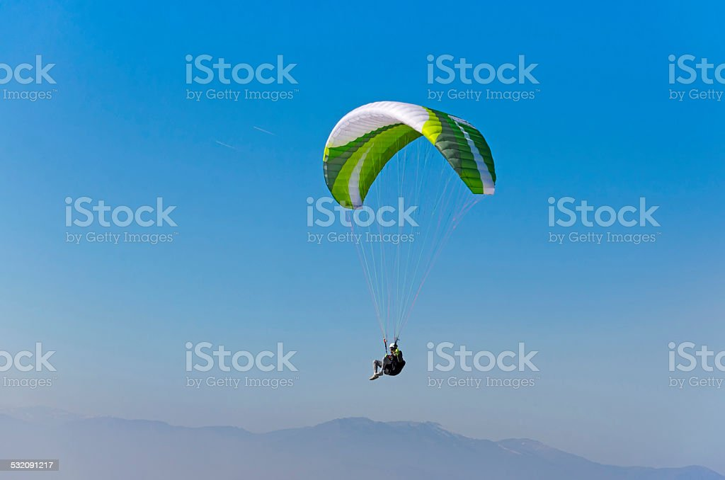 Sepia paraglide silhouette over Alps peaks stock photo