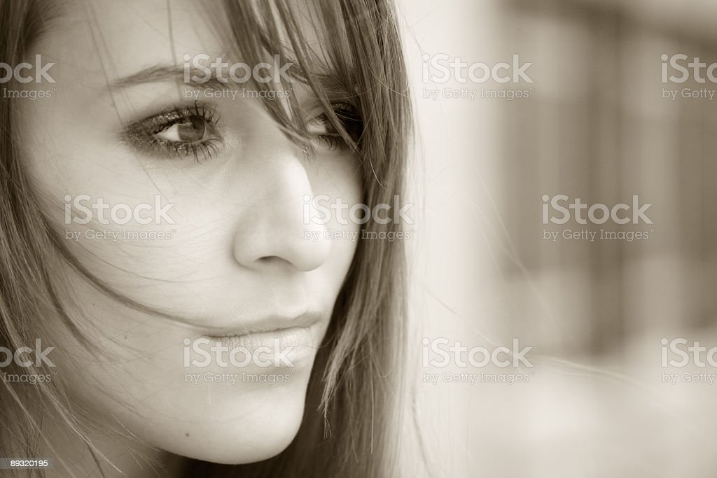 A sepia photoshoot of a young adolescent royalty-free stock photo