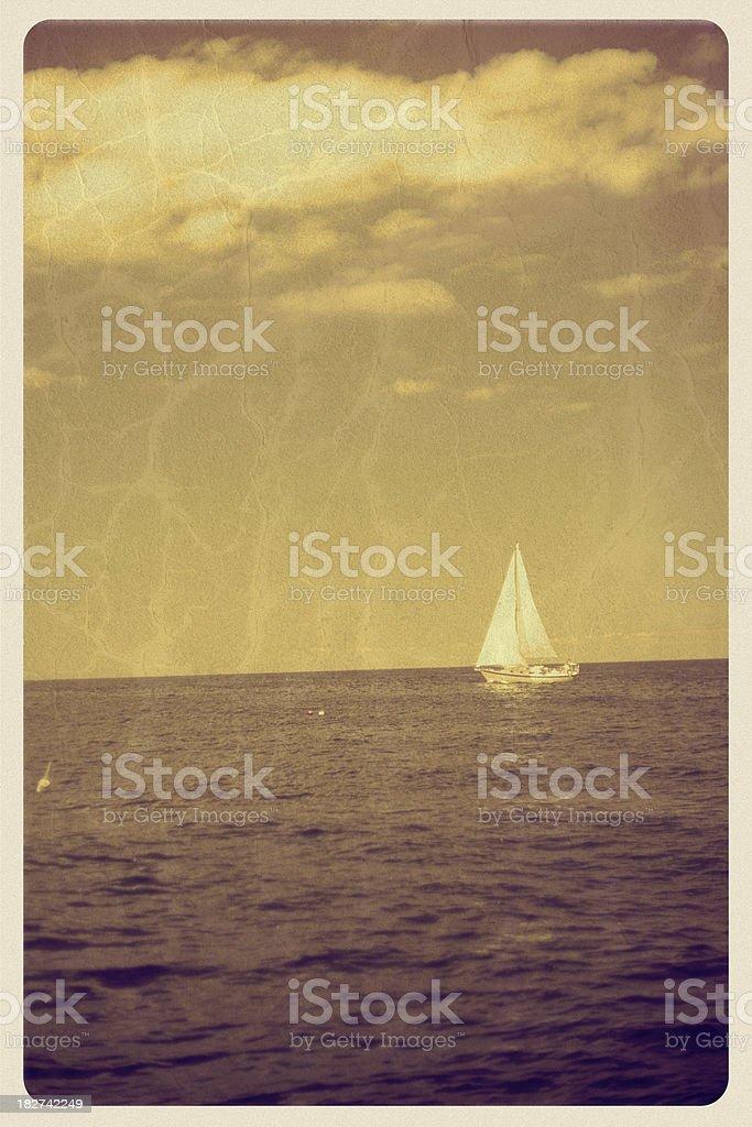 Sepia Sailboat on the Ocean - Vintage Postcard stock photo