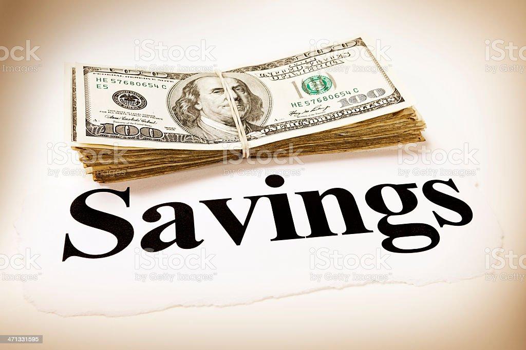 Sepia toned big bundle of US dollars and savings headline royalty-free stock photo
