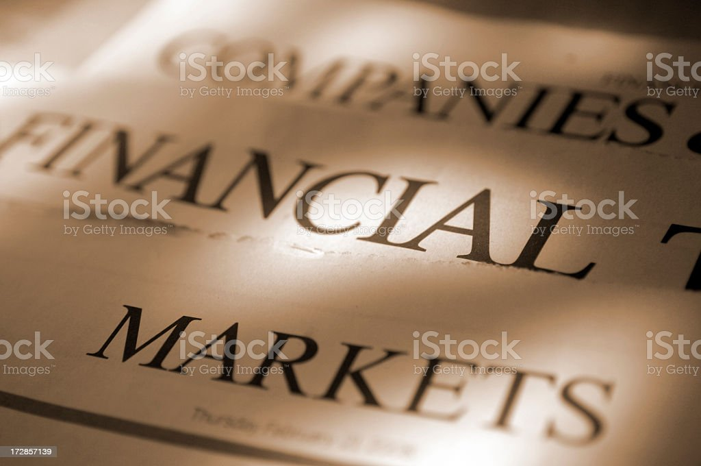 Sepia Toned Financial Newspapers stock photo