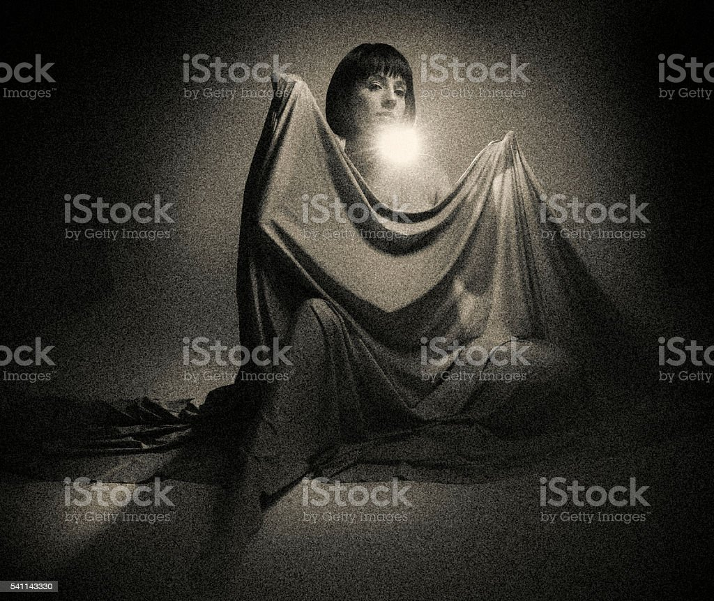 Sepia toned, Grainy photo of a mysterious woman stock photo