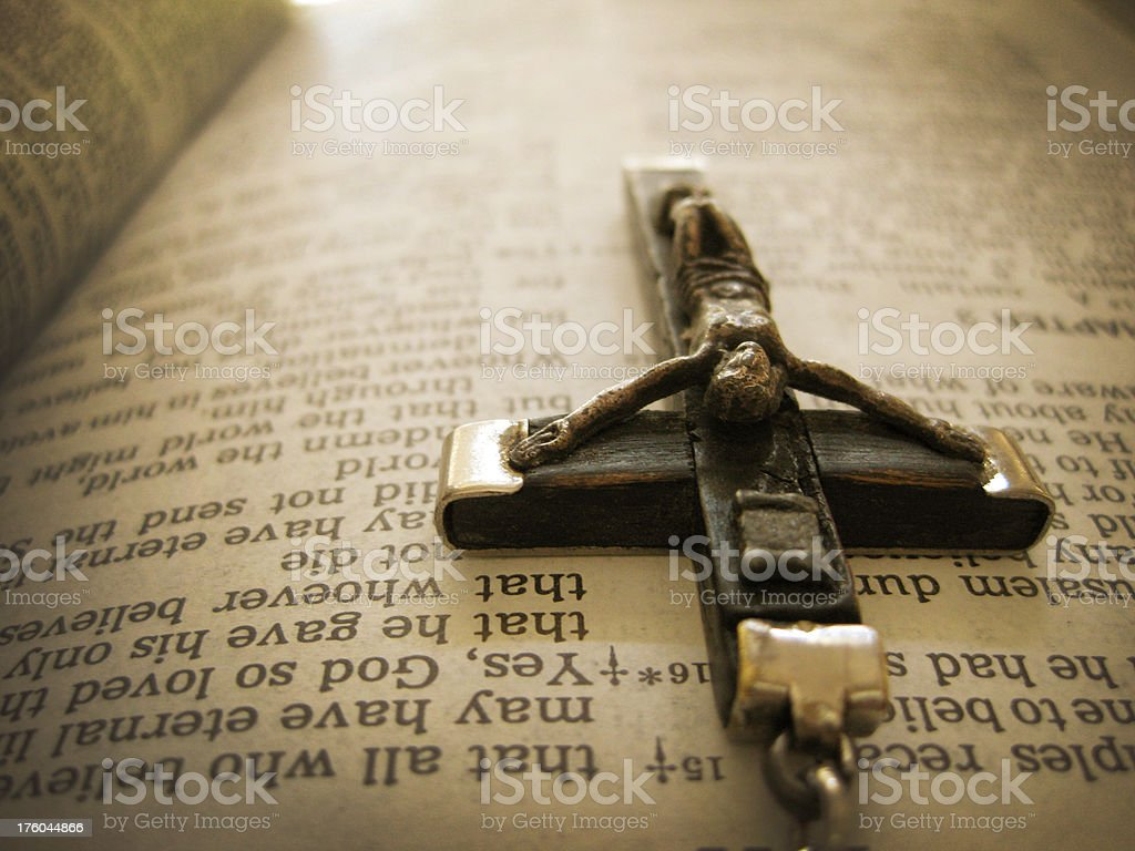 Sepia toned Handmade Cross on Bible Page Book of John royalty-free stock photo