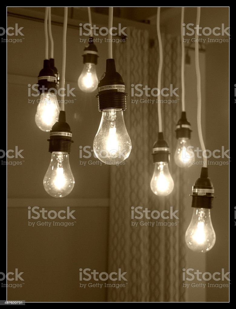 Sepia Toned Hanging Lightbulbs in a Row stock photo