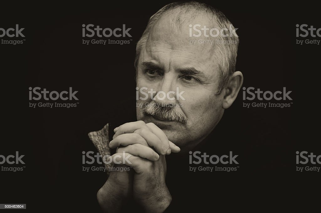 Sepia toned image of a thoughtful Caucasian man stock photo
