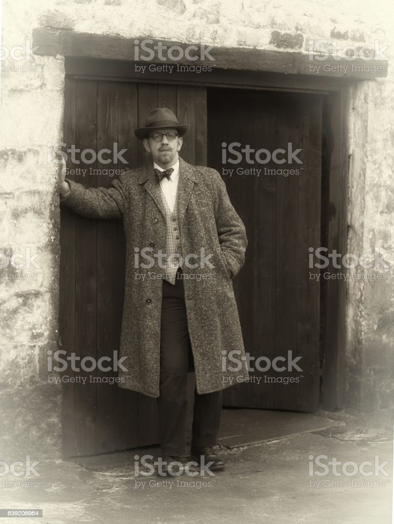 sepia toned image of mature man in vintage clothing stock photo