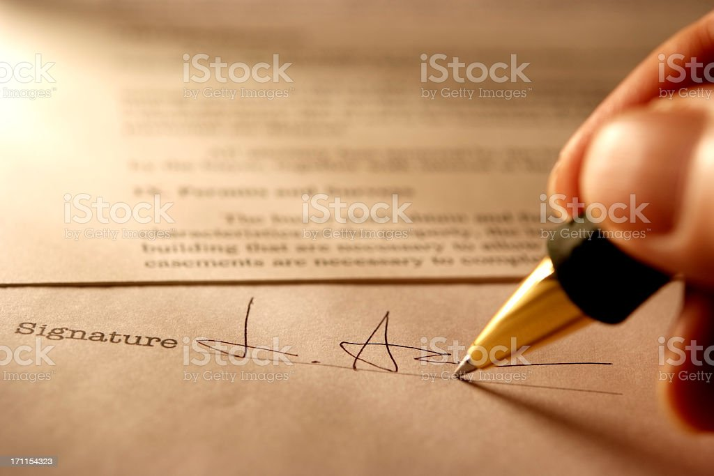 Sepia toned Image of signing a contract with light rays stock photo