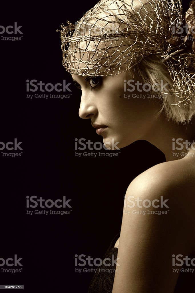 Sepia toned portrait of attractive retro-style girl in bonnet royalty-free stock photo