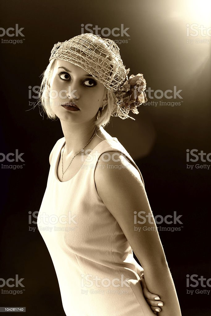 Sepia toned portrait of beautiful retro-style woman in bonnet royalty-free stock photo