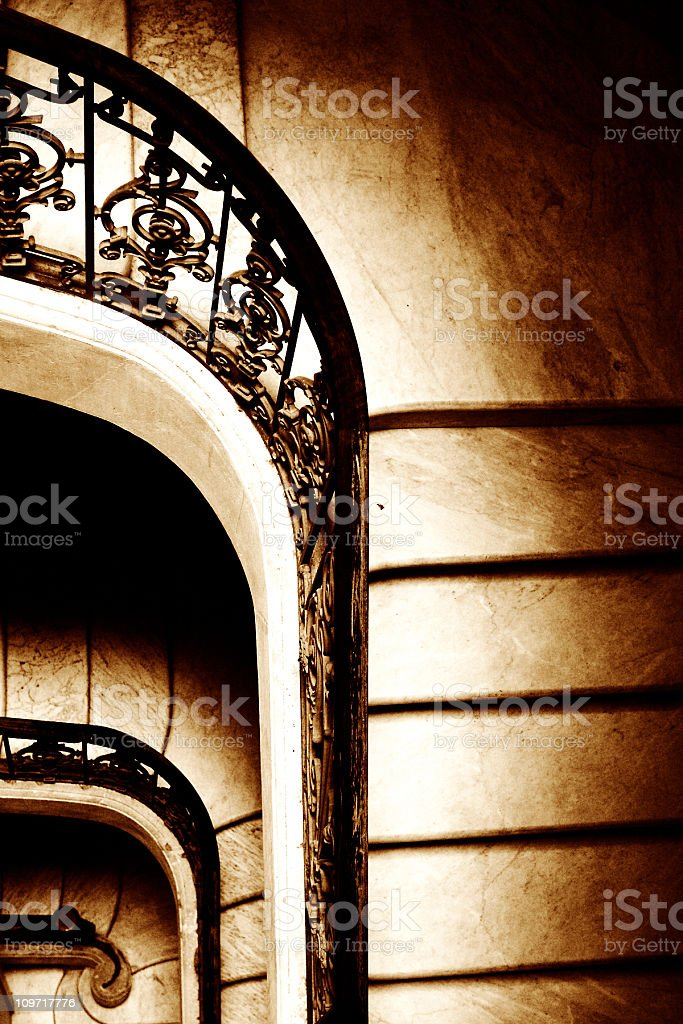 Sepia Toned Portrait of Marble Staircase with Wrought Iron Railing stock photo