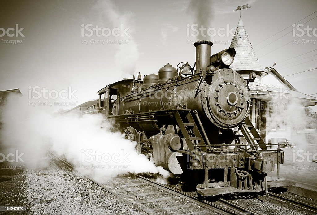Sepia Toned Vintage Steam Engine Locomotive Train Leaving Station stock photo