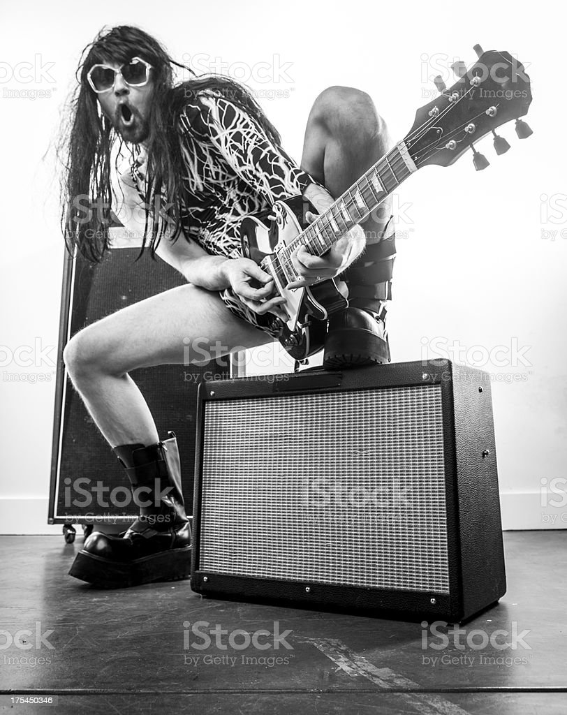 Sepia Wigged Rocker with Sunglasses Electric Guitar and Amps stock photo