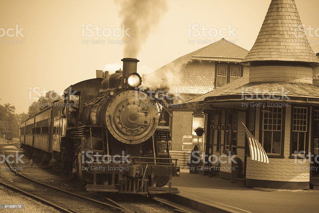 Sepia-toned Antique Steam Locomotive Engine at Train Station Platform stock photo