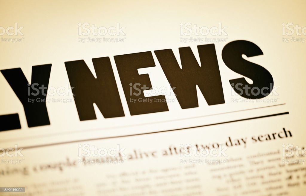 Sepia-toned, cropped portion of newspaper front page stock photo