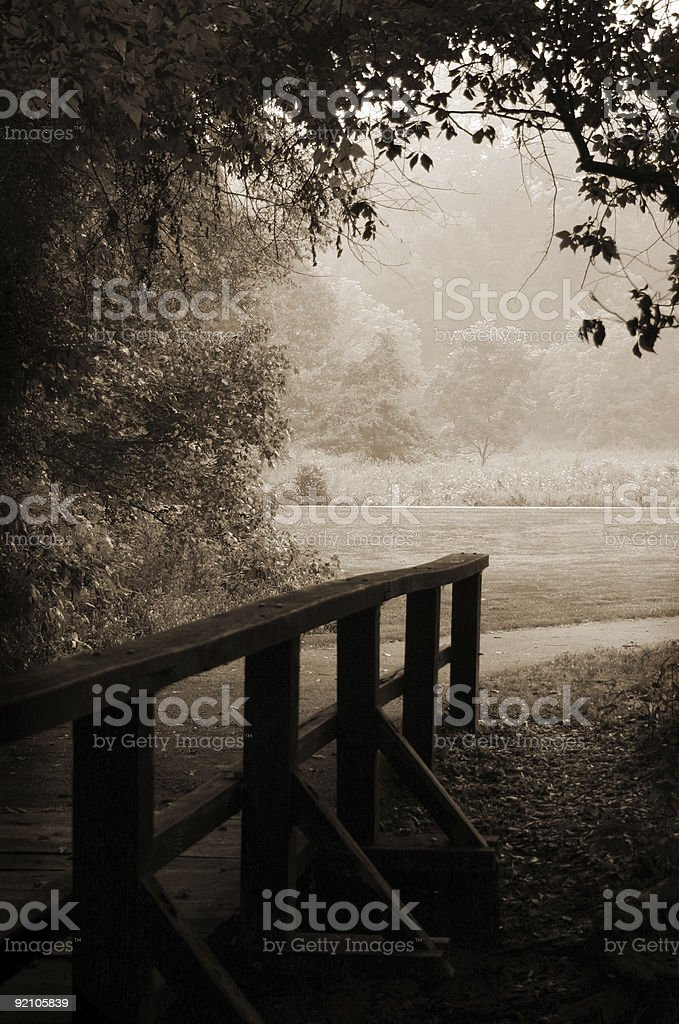 Sepia-toned wooden bridge and path royalty-free stock photo