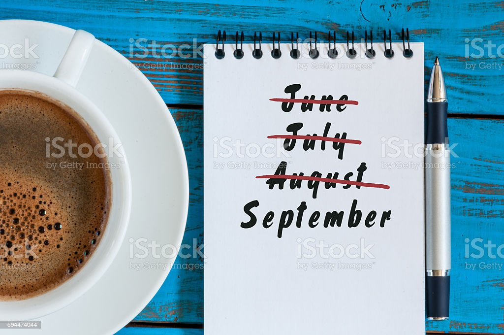 September beginning and summer end concept written at notepad with stock photo