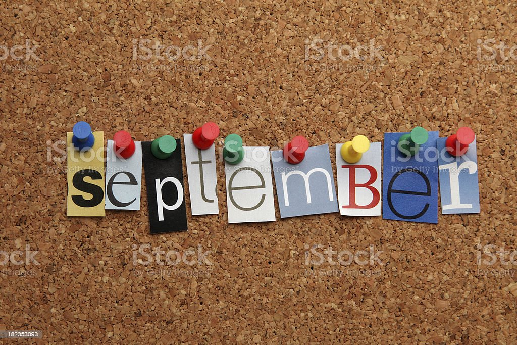 September pinned on noticeboard stock photo