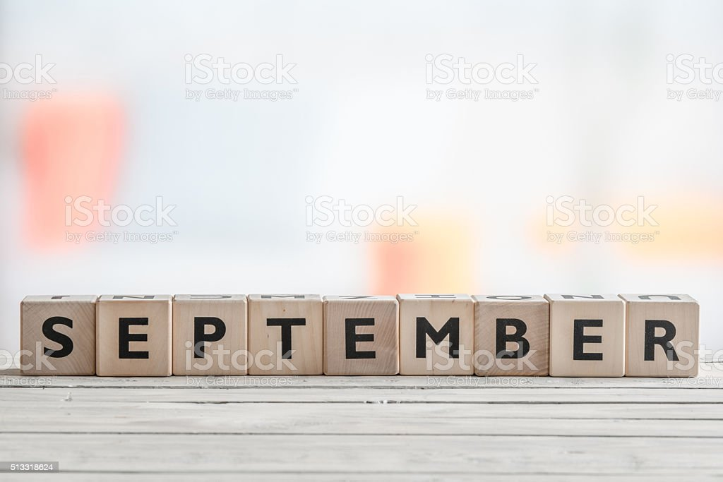 September sign on a wooden table stock photo