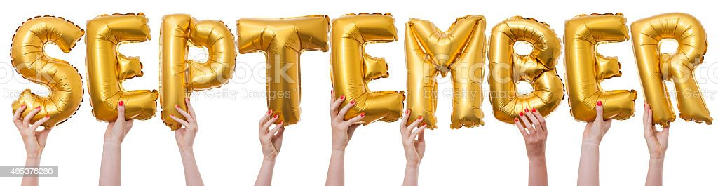 September word made from gold balloons stock photo