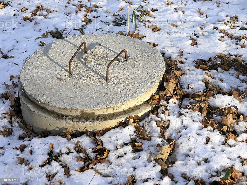 Septic tank cover - winter stock photo