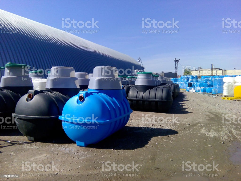 Septic tanks and other storage tanks at the manufacturer factory depot stock photo