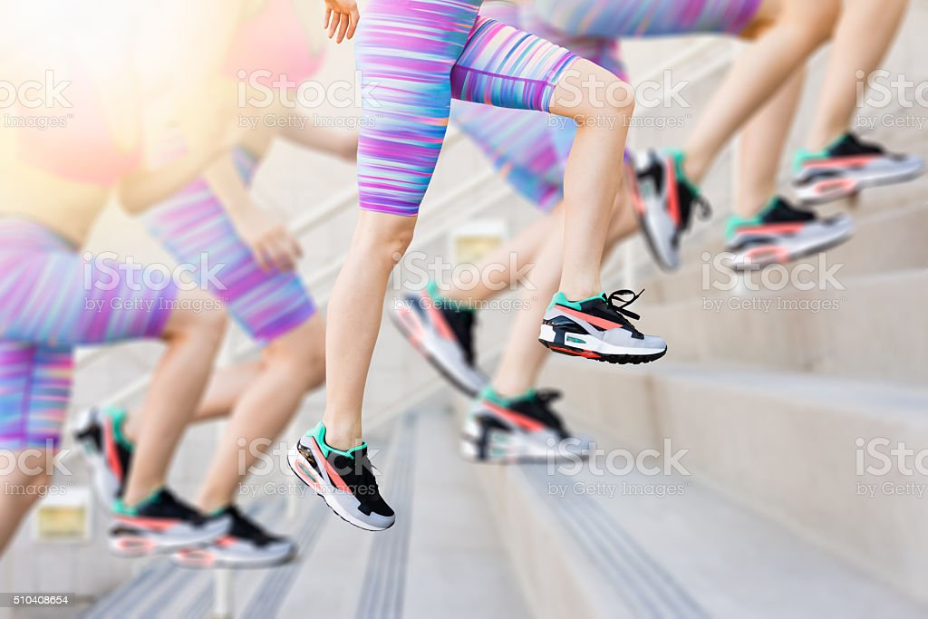 Sequence of a Women Runner Training On The Stairs stock photo