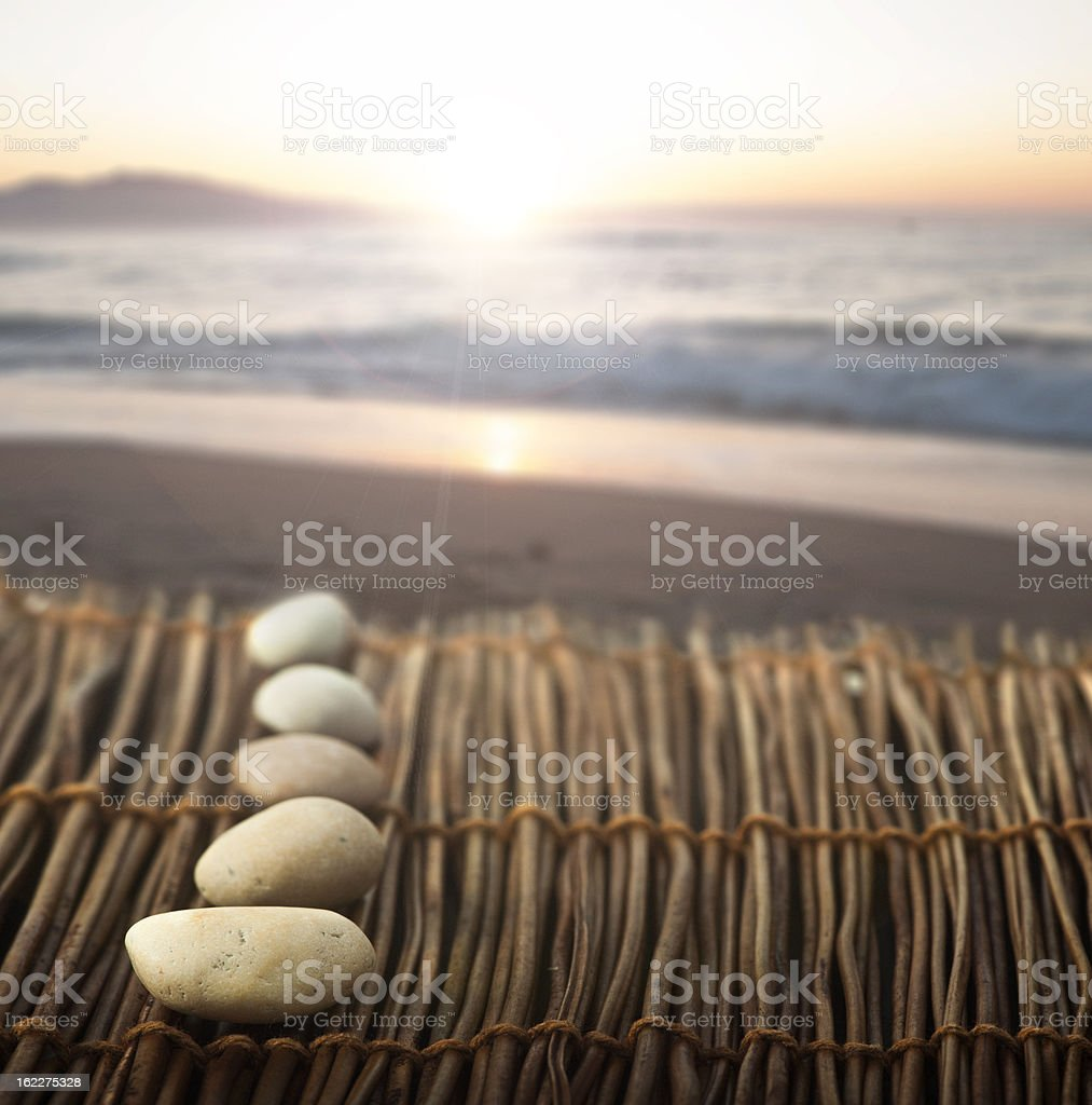 Sequence of stones on wooden base for spa royalty-free stock photo