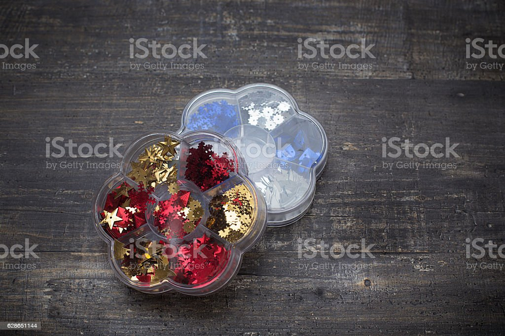 Sequins in two boxes stock photo