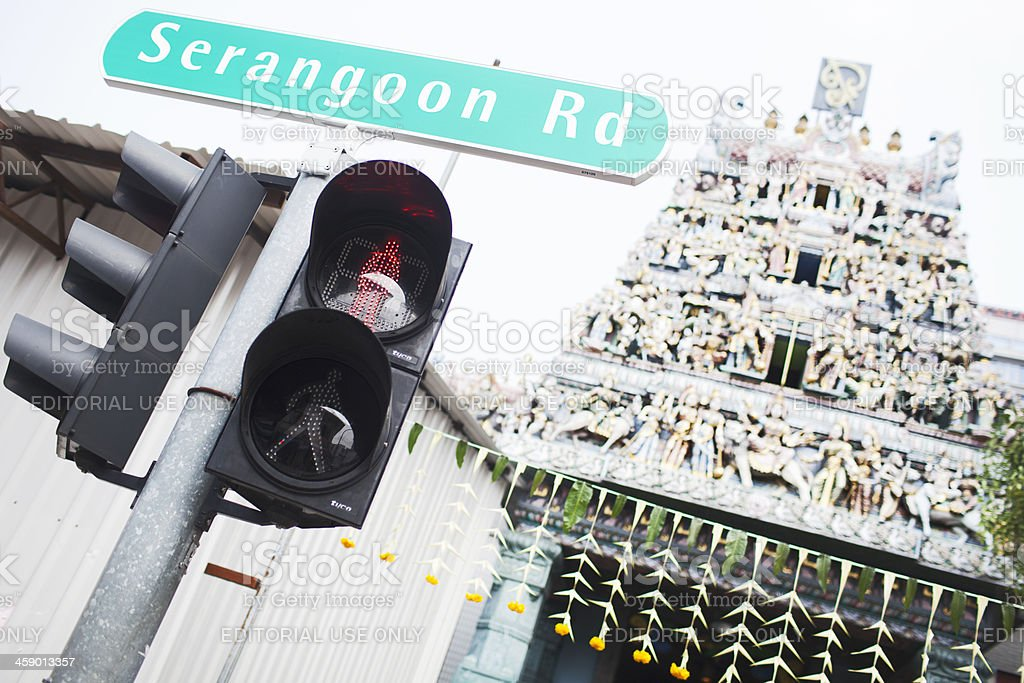 Serangoon Raod sign in front of Hindu temple. stock photo