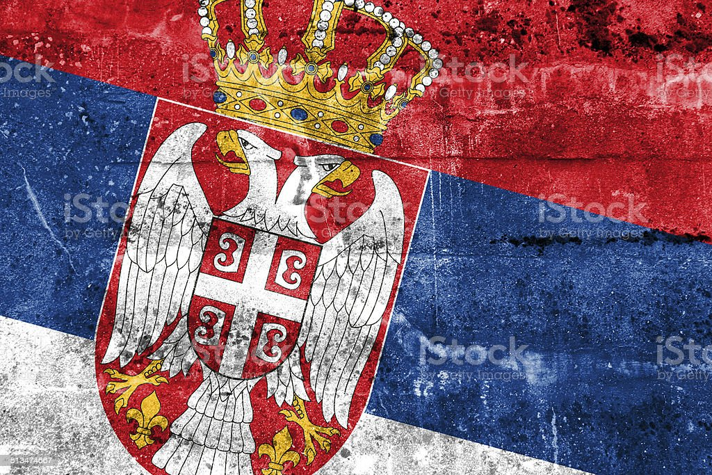 Serbia Flag painted on grunge wall stock photo