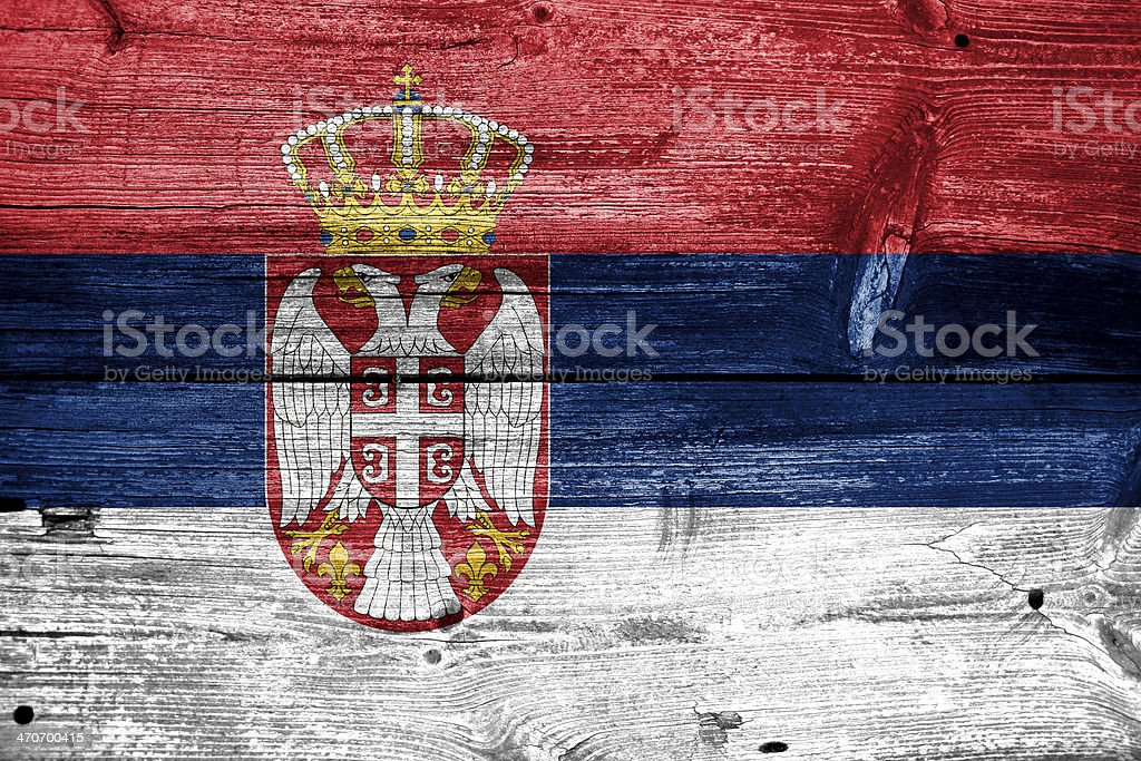 Serbia Flag painted on old wood plank texture stock photo