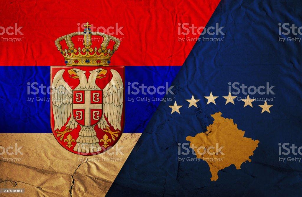 Serbian and Kosovo grunge flag stock photo