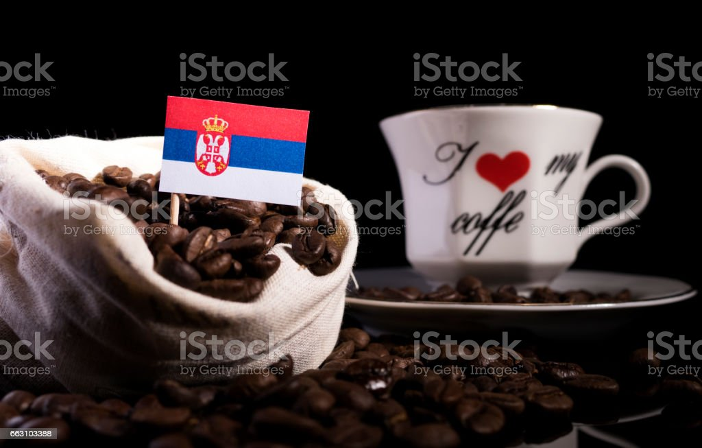 Serbian flag in a bag with coffee beans isolated on black background stock photo