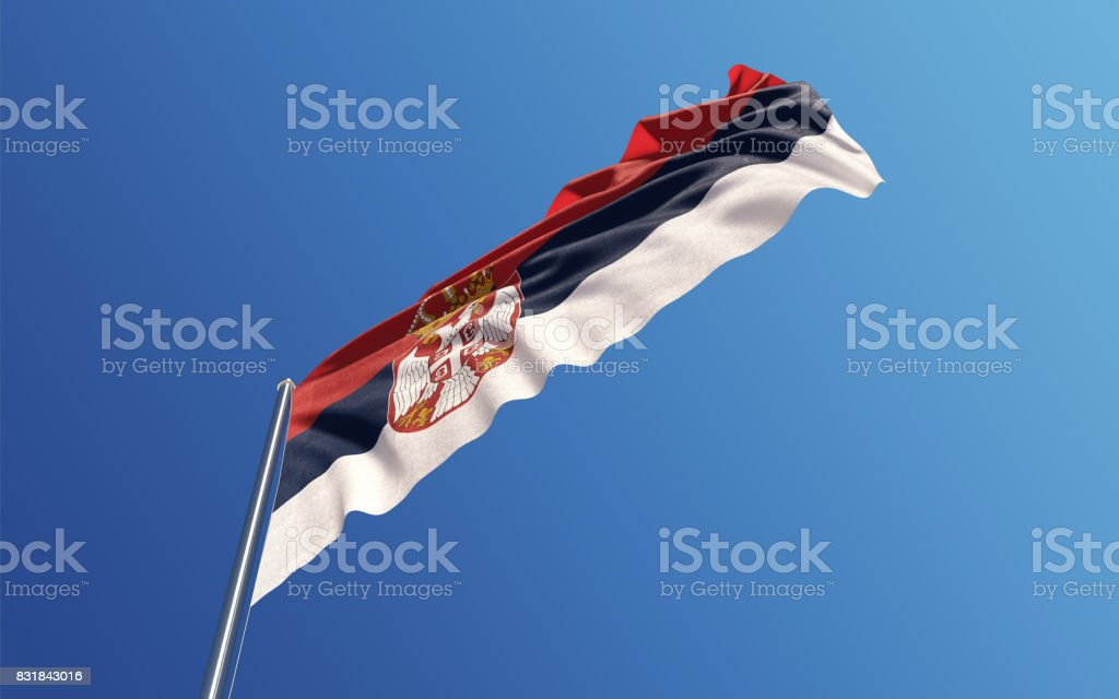 Serbian Flag Waving With Wind On Blue Sky stock photo