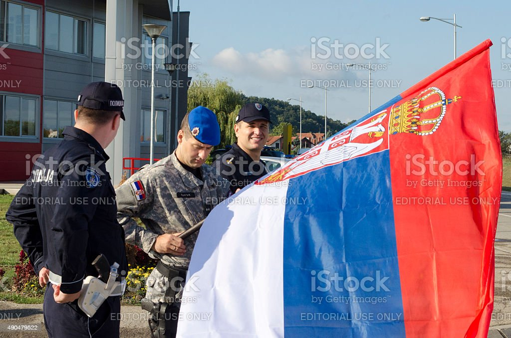 Serbian police with flag stock photo