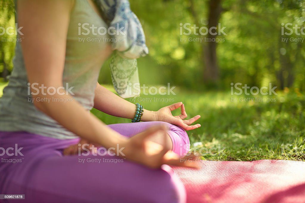 Serene and peaceful woman practicing mindful awareness mindfulness by meditating stock photo