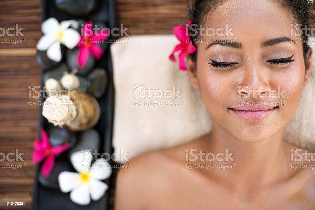 Serene beautiful spa woman relaxing stock photo