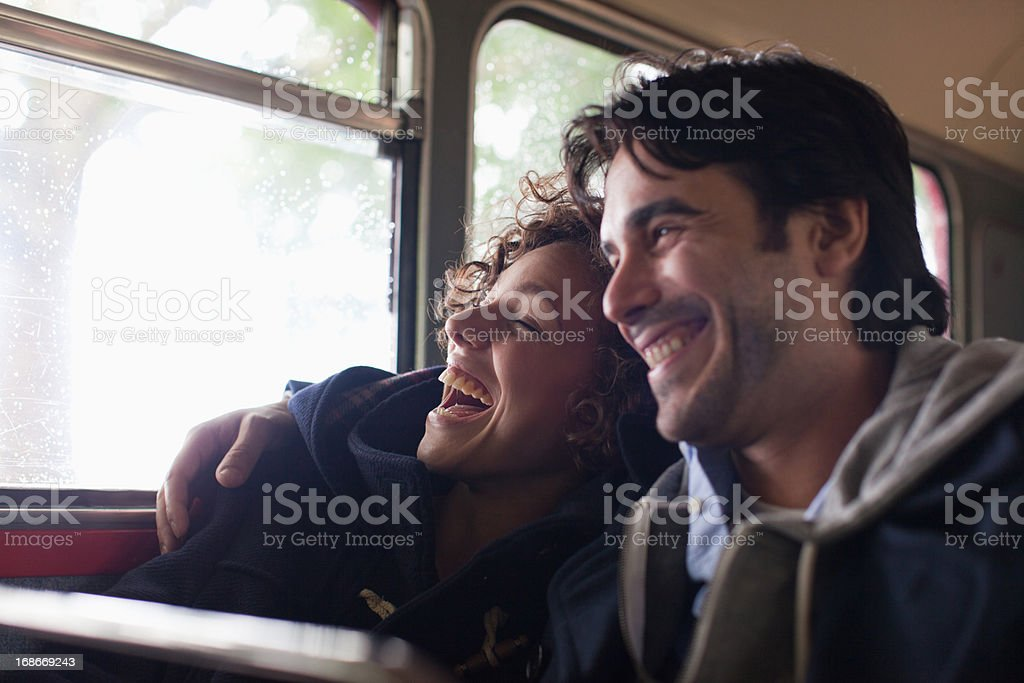 Serene couple hugging on bus royalty-free stock photo