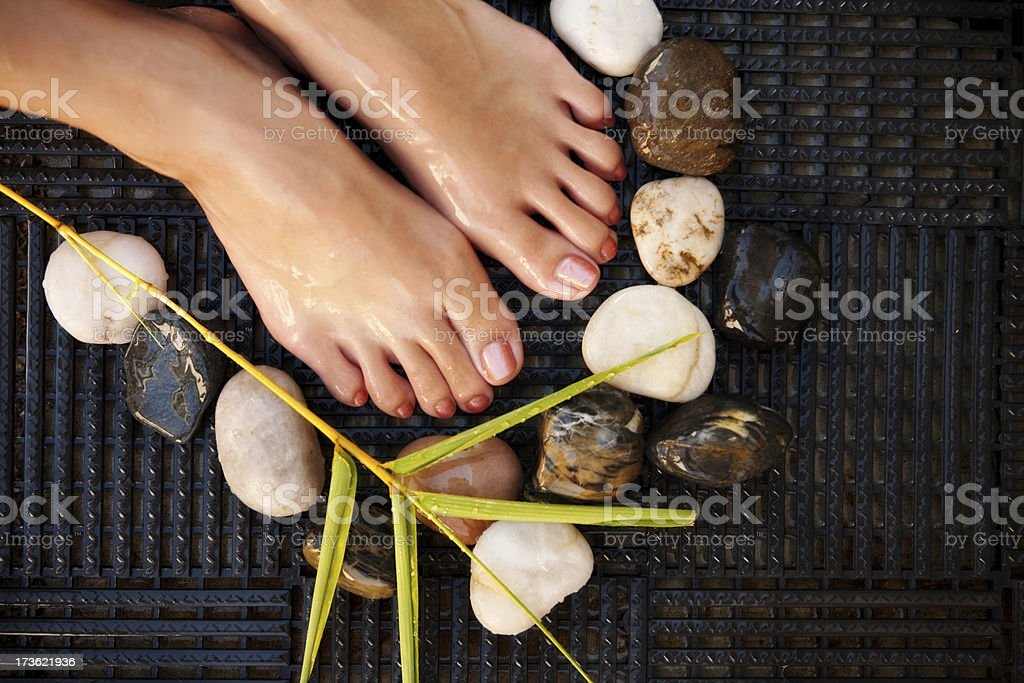 serene foot with natural elements royalty-free stock photo