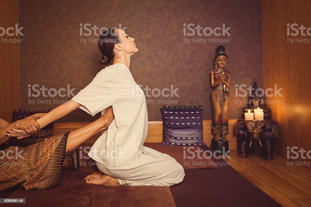 Serene girl enjoying thai massage stock photo