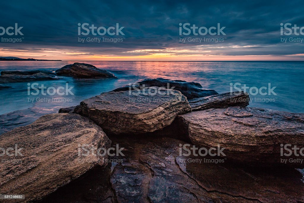 Serene long exposure seascape view before sunrise - Stock image stock photo