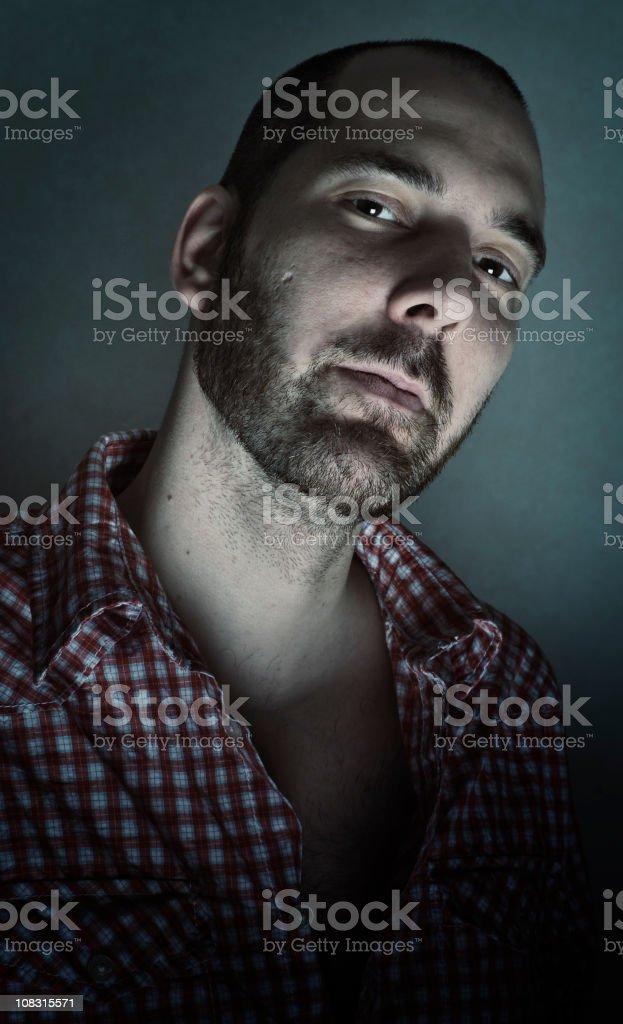 Serene Man in Moody Light, Low Key royalty-free stock photo
