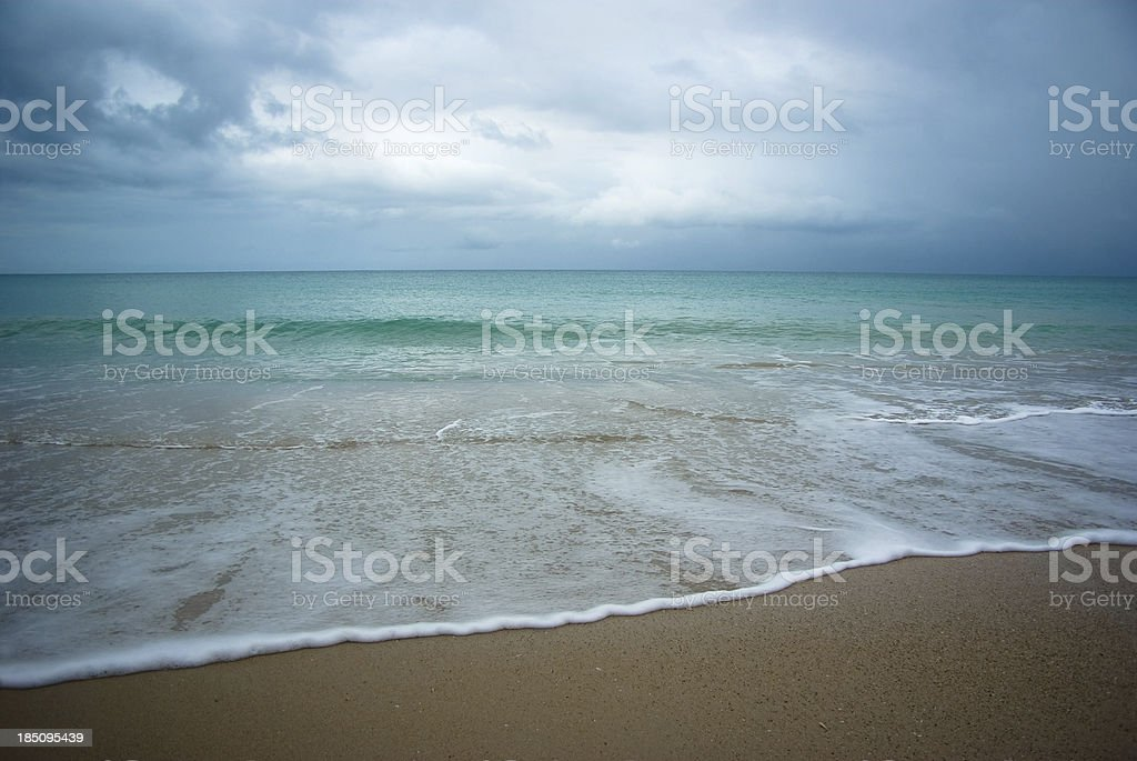 serene sea and shore with stormy clouds royalty-free stock photo