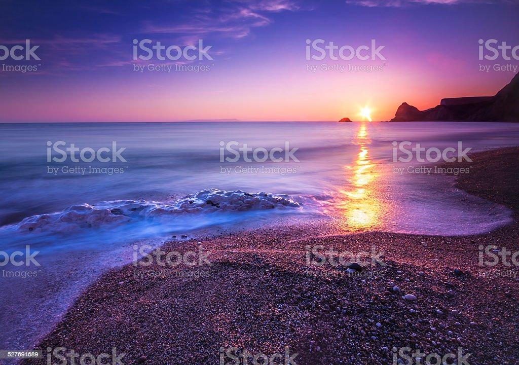 Serene South Dorset Beach and Sea at Sunset stock photo