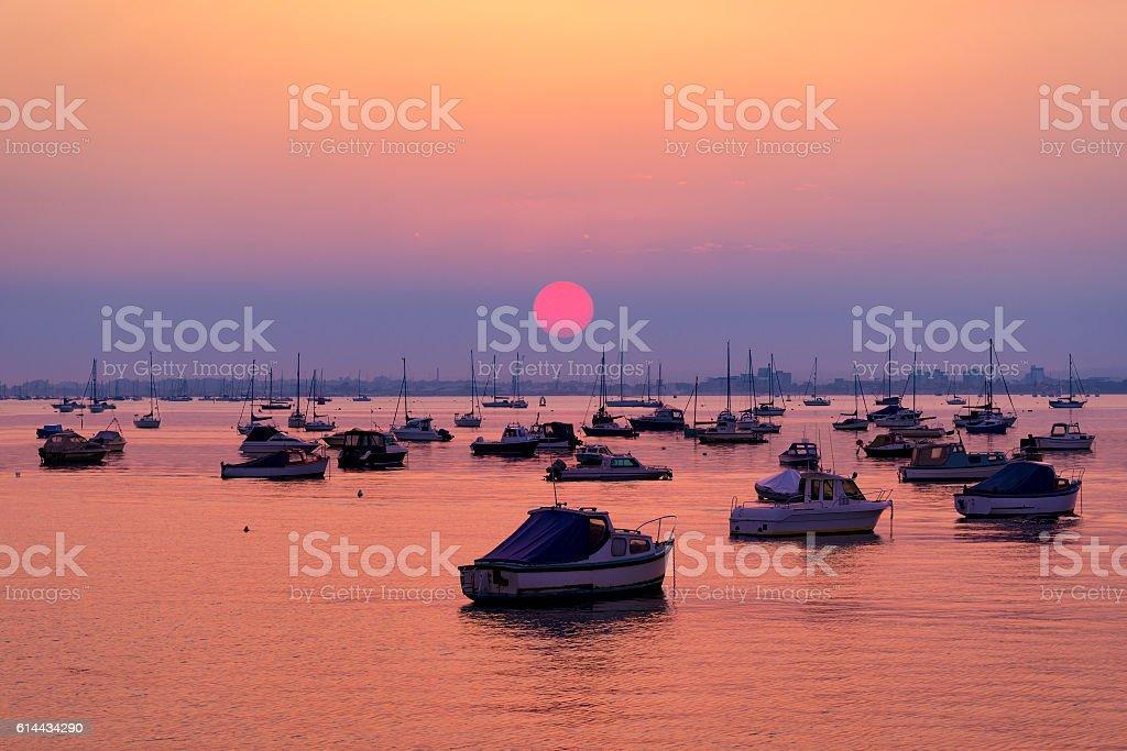 Serene sunset over boats at Sandbanks, Poole, Dorset near Bournemouth stock photo