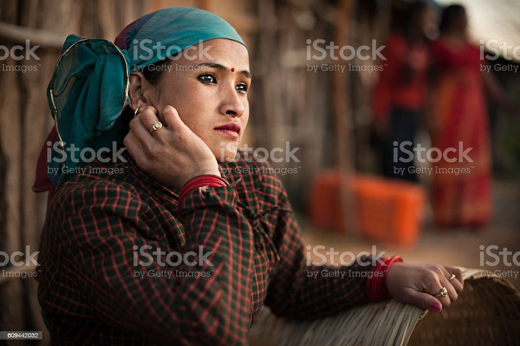 Serene, traditional Asian peasant woman looking away and thinking. stock photo