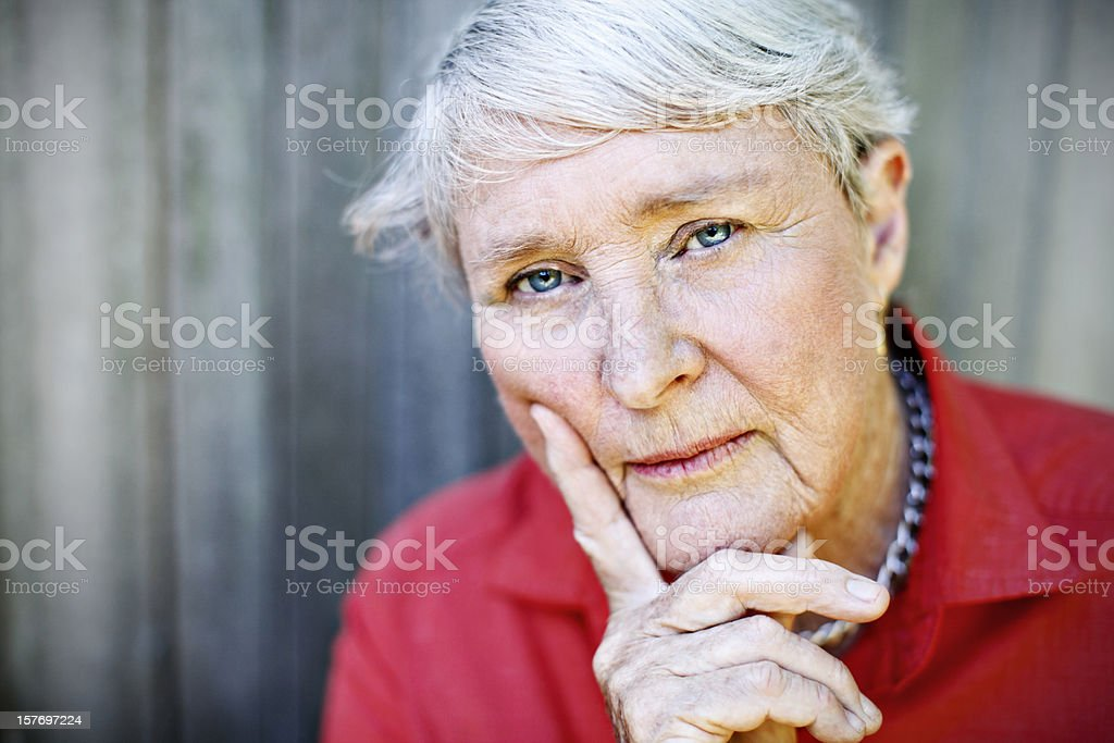 Serene woman in her 70s looks ahead confidently royalty-free stock photo