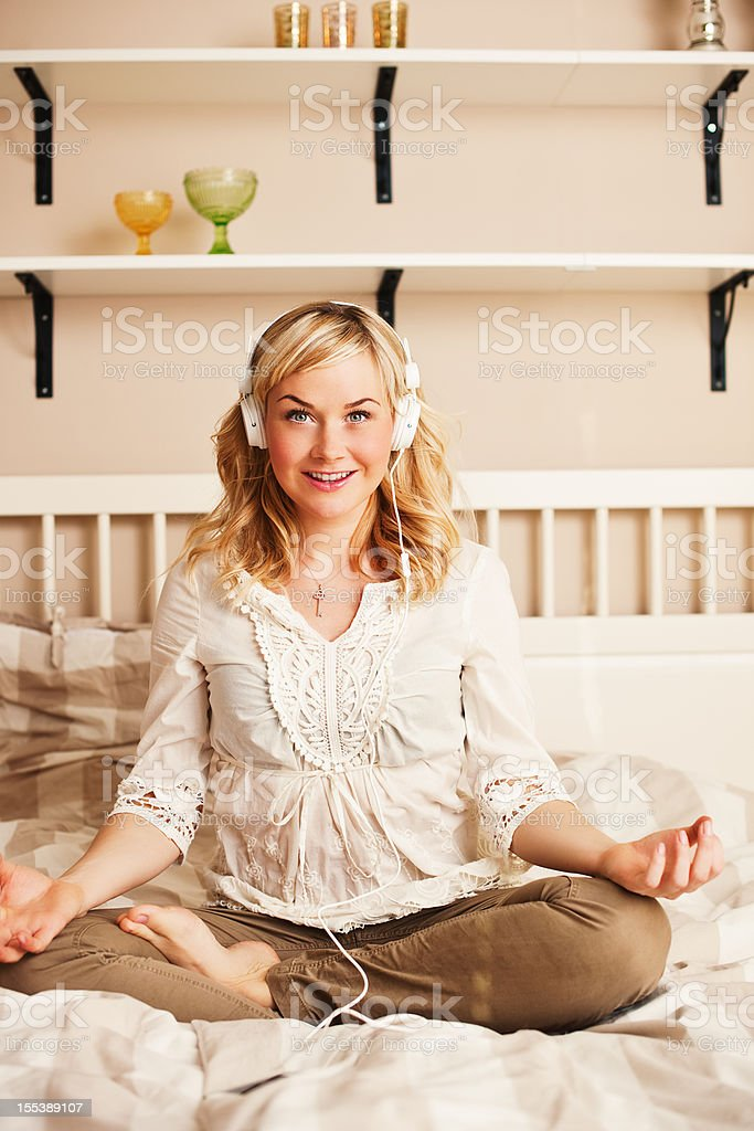Serene woman in lotus position royalty-free stock photo